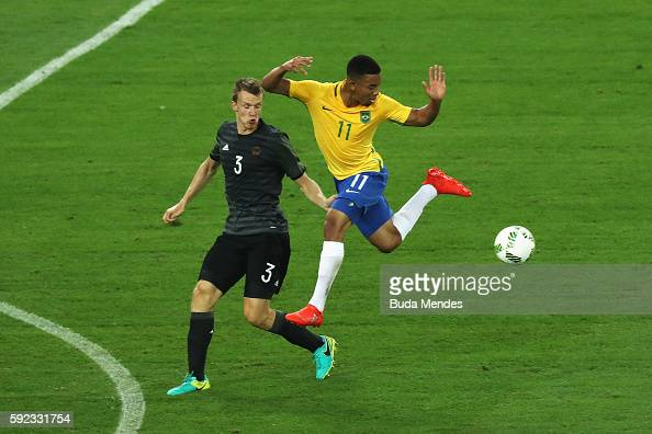http://media.gettyimages.com/photos/lukas-klostermann-of-germany-and-gabriel-jesus-of-brazil-challenge-picture-id592331754?s=594x594
