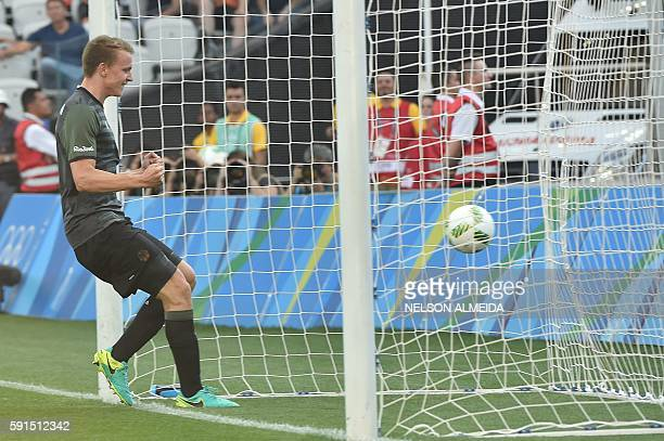 Lukas Klostermann of Germany celebrates his goal scored against Nigeria during their Rio 2016 Olympic Games men's football semifinal match at the...