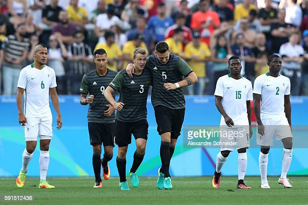 Lukas Klostermann of Germany celebrates kicking a goal with team mate Niklas Suele of Germany during the Men's Semifinal Football match between...
