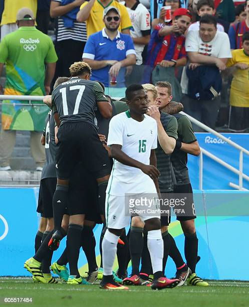Lukas Klostermann of Germany celebrates with team mates after scoring a goal during the Men's Football Semi Final between Nigeria and Germany on Day...