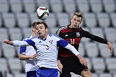 Lukas Klostermann of Germany challenges Gestur Dam of Faroe Island during the 2017 UEFA European U21 Championships Qualifier between U21 Faroe...