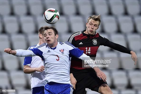 Lukas Klostermann of Germany challenges Gestur Dam of Faroe Island during the 2017 UEFA European U21 Championships Qualifier between U21 Faroe...