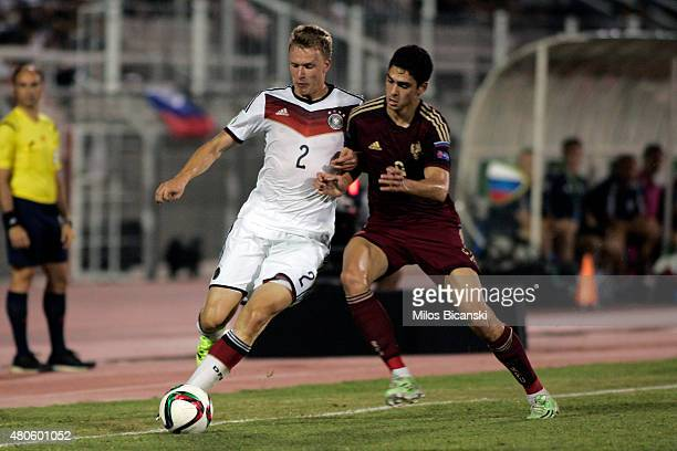 Lukas Klostermann of Germany competes with Ramil Sheydaev of Russia during the UEFA European Under19 Championship group stage match between U19...