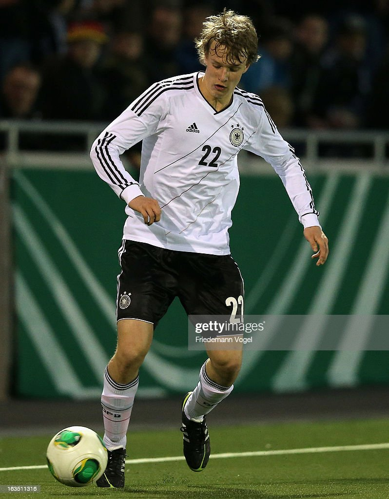 Lukas Klostermann of Germany runs with the ball during the U17 International Friendly match between Germany and Georgia at Toennies-Arena on March 6, 2013 in Rheda-Wiedenbruck, Germany.