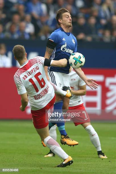 Lukas Klostermann of Leipzig and Bastian Oczipka of Schalke during the Bundesliga match between FC Schalke 04 and RB Leipzig at VeltinsArena on...