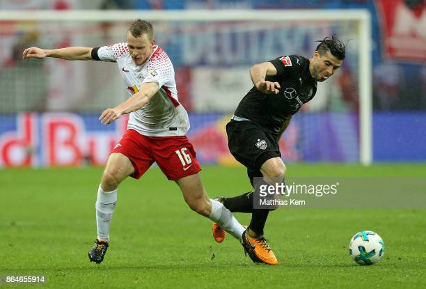 Lukas Klostermann of Leipzig battles for the ball with Emiliano Insua Zapata of Stuttgart during the Bundesliga match between RB Leipzig and VfB...