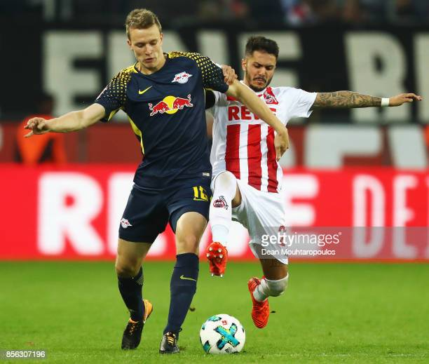 Lukas Klostermann of RB Leipzig battles for the ball with Leonardo Bittencourt of FC Koeln during the Bundesliga match between 1 FC Koeln and RB...