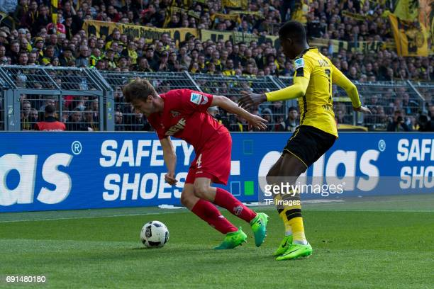 Lukas Kluenter of Colonge and Ousmane Dembele of Dortmund battle for the ball during the Bundesliga match between Borussia Dortmund and FC Koeln at...