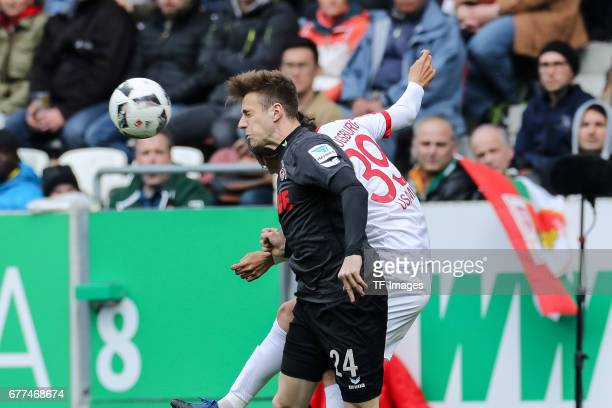 Lukas Kluenter of Colonge and Takashi Usami of Augsburg battle for the ball during the Bundesliga match between FC Augsburg and 1 FC Koeln at WWK...