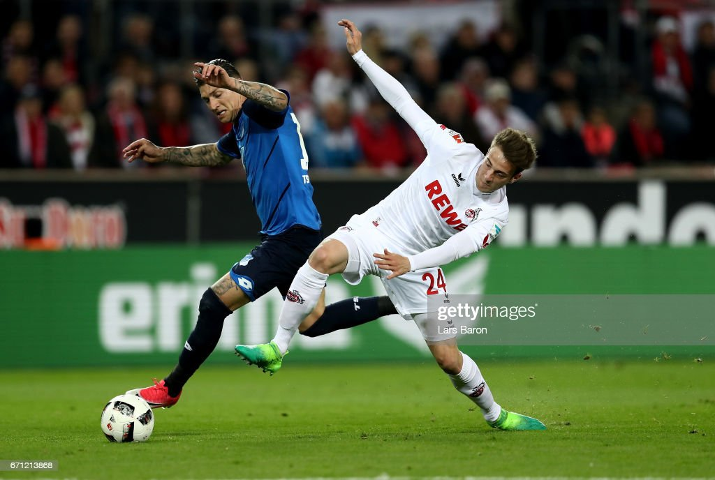 Lukas Kluenter (R) of Koeln and Steven Zuber of Hoffenheim battle for the ball during the Bundesliga match between 1. FC Koeln and TSG 1899 Hoffenheim at RheinEnergieStadion on April 21, 2017 in Cologne, Germany.