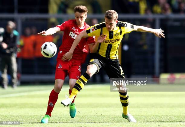 Lukas Kluenter of Koeln is challenged by Matthias Ginter of Dortmund during the Bundesliga match between Borussia Dortmund and 1 FC Koeln at Signal...