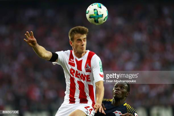 Lukas Klunter of FC Koeln battles for the ball with Bruma of RB Leipzig during the Bundesliga match between 1 FC Koeln and RB Leipzig at...
