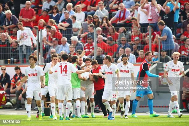 Lukas Klunter of Koeln celebrates scoring his teams second goal of the game with team mates during the Bundesliga match between Bayer 04 Leverkusen...