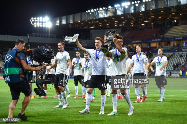 Lukas Klunter Thilo Kehrer celebrates withe the trophy after the UEFA European Under21 final match between Germany and Spain on June 30 2017 in...