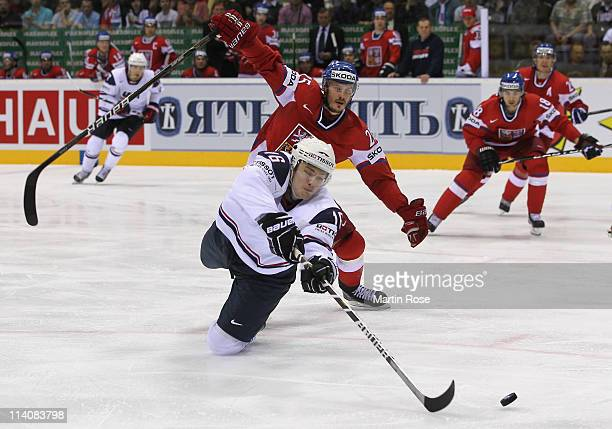 Lukas Krajicek of Czech Republic and James van Riemsdyk of USA battle for the puck during the IIHF World Championship quarter final match between...