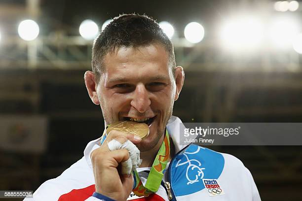 Lukas Krpalek of the Czech Republic celebrates on the podium after the men's 100kg gold medal judo contest against Elmar Gasimov of Azerbaijan on Day...
