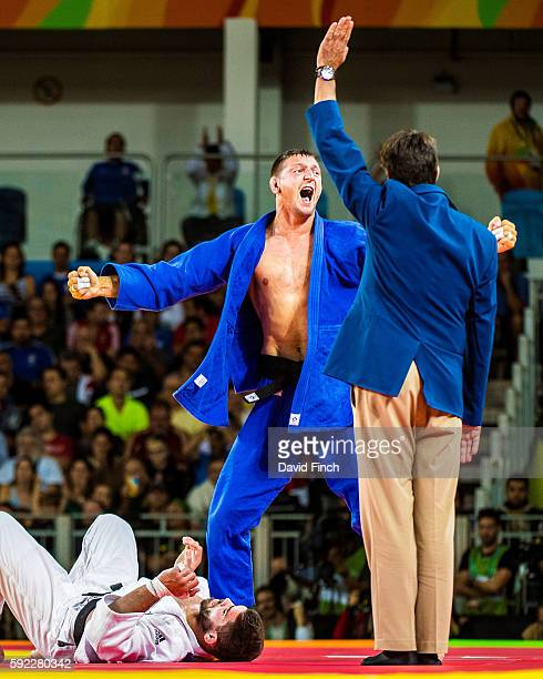 Lukas Krpalek of the Czech Republic leaps up after holding Cyrille Maret of France for an ippon to reach the u100kg final where he won the gold medal...