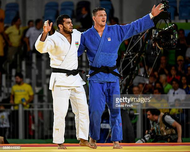 Lukas Krpalek of the Czech Republic shares the stage with defeated Elmar Gasimov of Azerbaijan after winning the u100kg gold medal during day 6 of...