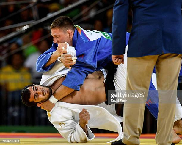 Lukas Krpalek of the Czech Republic throws Elmar Gasimov of Azerbaijan for an ippon to win the u100kg judo gold medal during Day 6 at the 2016 Rio...