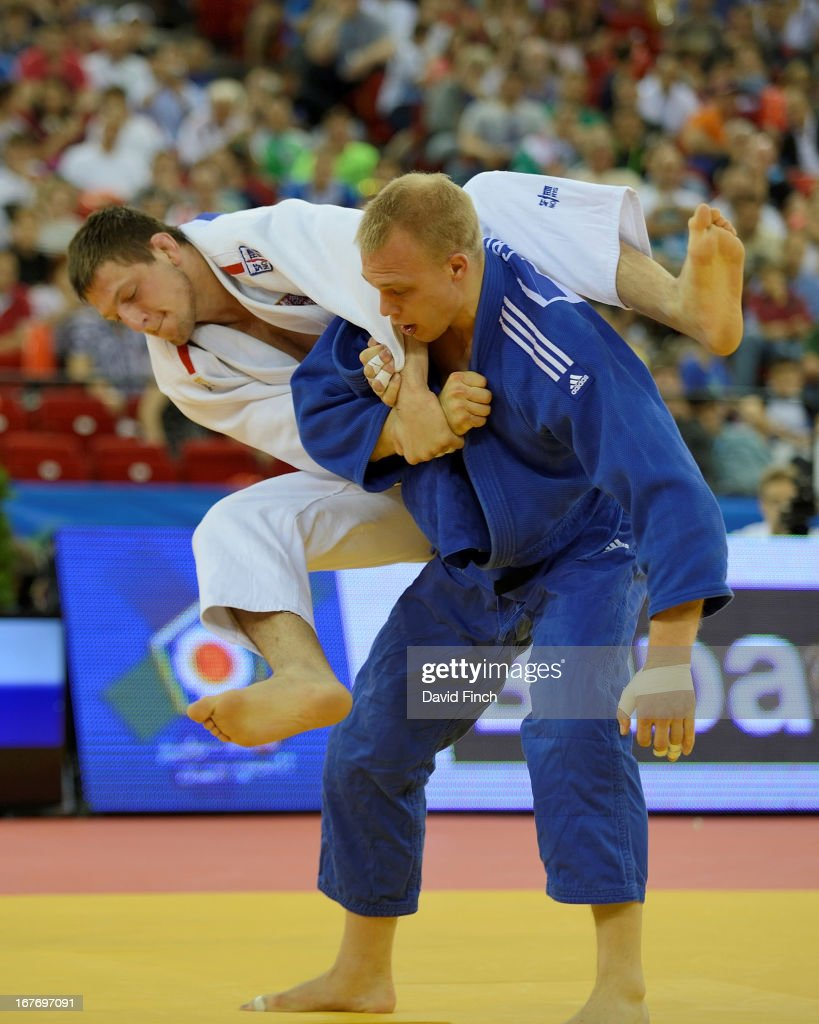 Lukas Krpalek of the Czeck Republic (white) attempts a leaping armlock against former World champion Henk Grol of Holland ahead of winning the u100kgs gold medal during the Budapest European Championships at the Papp Laszlo Sports Hall on April 27, 2013 in Budapest, Hungary.