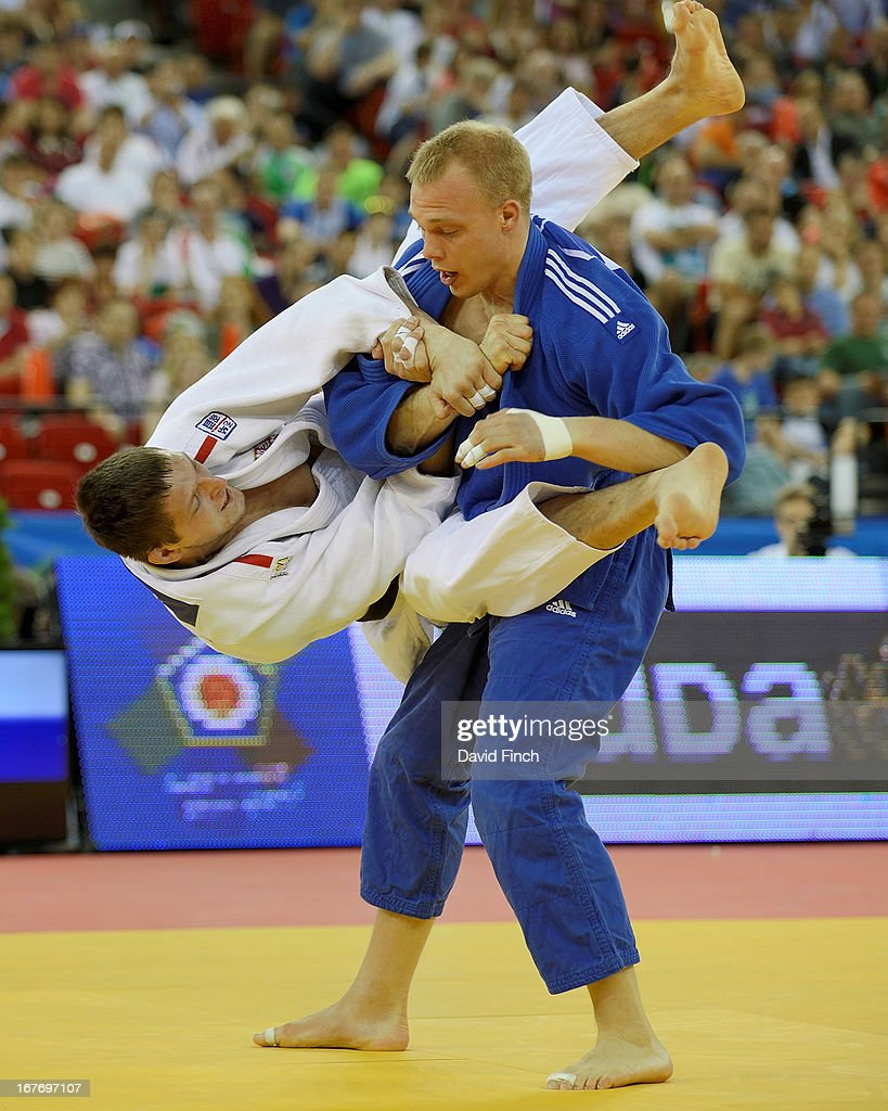 Lukas Krpalek of the Czeck Republic (white) attempts a leaping armlock against former World champion <a gi-track='captionPersonalityLinkClicked' href=/galleries/search?phrase=Henk+Grol&family=editorial&specificpeople=4920749 ng-click='$event.stopPropagation()'>Henk Grol</a> of Holland on his way to winning the u100kgs gold medal during the Budapest European Championships at the Papp Laszlo Sports Hall on April 27, 2013 in Budapest, Hungary.