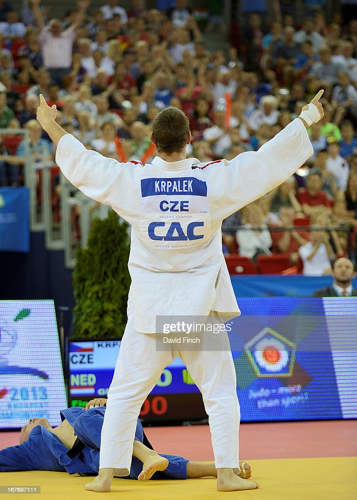 Lukas Krpalek of the Czeck Republic (white) celebrates defeating former World champion <a gi-track='captionPersonalityLinkClicked' href=/galleries/search?phrase=Henk+Grol&family=editorial&specificpeople=4920749 ng-click='$event.stopPropagation()'>Henk Grol</a> of Holland for the u100kgs gold medal during the Budapest European Championships at the Papp Laszlo Sports Hall on April 27, 2013 in Budapest, Hungary.