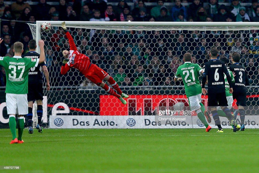 Lukas Kruse of Paderborn gest the first goal of Zlatko Junuzovic of Bremen during the Bundesliga match between Werder Bremen and SC Paderborn at...