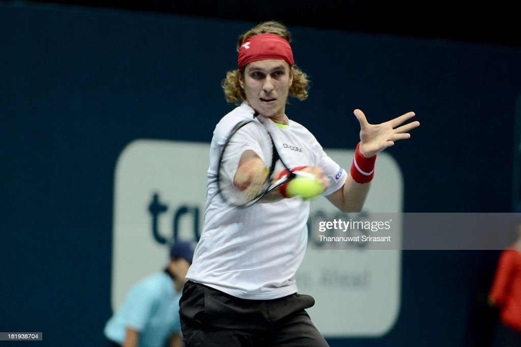 Lukas Lacko of Slovakia plays a shot in his match against Richard Gasquet of France during the 2013 Thailand Open at Impact Arena on September 26, 2013 in Bangkok, Thailand.