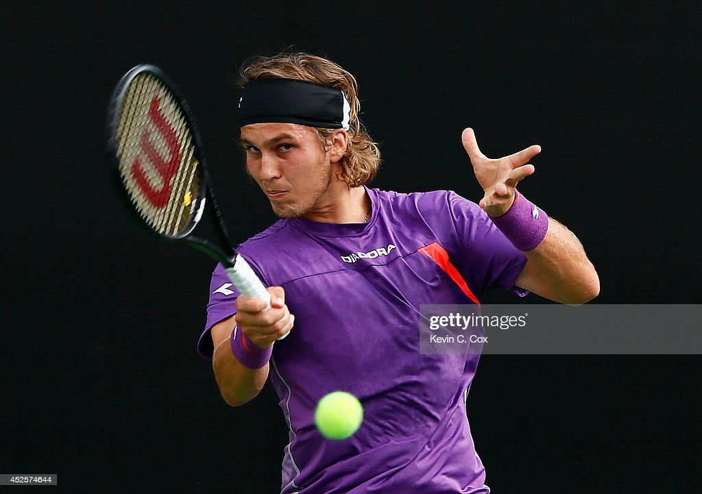 Lukas Lacko of Slovakia returns a forehand to Denis Istomin of Uzbekistan during the BB&T Atlanta Open at Atlantic Station on July 23, 2014 in Atlanta, Georgia.