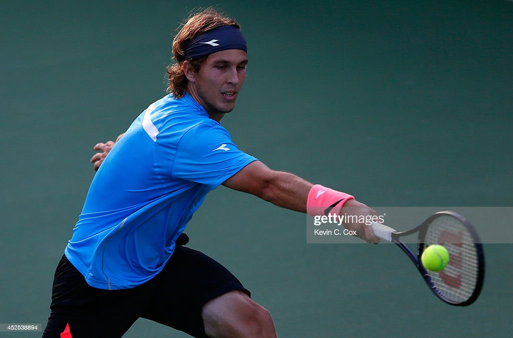 <a gi-track='captionPersonalityLinkClicked' href=/galleries/search?phrase=Lukas+Lacko&family=editorial&specificpeople=821897 ng-click='$event.stopPropagation()'>Lukas Lacko</a> of Slovakio chases down a shot by Nathan Pasha during the BB&T Atlanta Open at Atlantic Station on July 22, 2014 in Atlanta, Georgia.