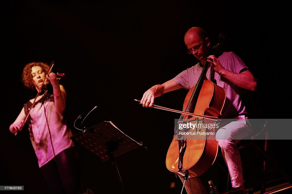 Lukas Lauermann (R) playing cello and Julia Pichler (L) playing violin from Alp Bora (Austria) featuring Turkey and Balkans music, a mix of Eastern and Western colours in Rainforest World Music Festival at Sarawak Cultural Village on June 28, 2013 in Kuching, Sarawak, Malaysia.