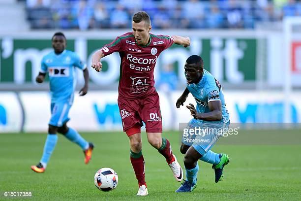 Lukas Lerager midfielder of SV Zulte Waregem is challenged by Anderson Esiti midfielder of KAA Gent during the Jupiler Pro League match between KAA...