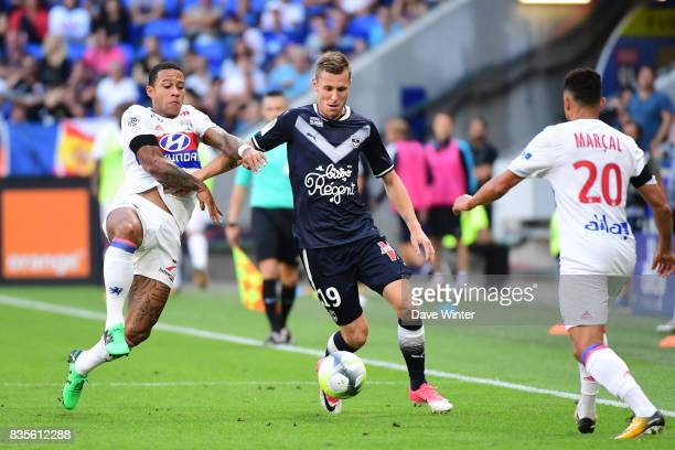 Lukas Lerager of Bordeaux and Memphis Depay of Lyon during the Ligue 1 match between Olympique Lyonnais and FC Girondins de Bordeaux at Groupama...