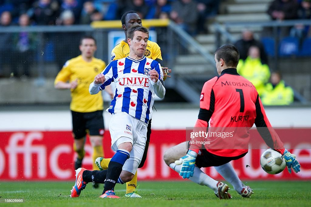Lukas Marecek of SC Heerenveen, Danilo Pereira of Roda JC Kerkrade, goalkeeper Filip Kurto of Roda JC Kerkrade during the Dutch Eredivisie match between SC Heerenveen and Roda JC Kerkrade at the Abe Lenstra Stadium on December 09, 2012 in Heerenveen, The Netherlands.