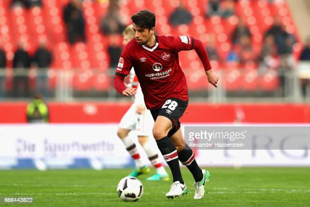 Lukas Muehl of Nuernberg runs with the ball during the Second Bundesliga match between 1 FC Nuernberg and FC St Pauli at Arena Nuernberg on April 7...