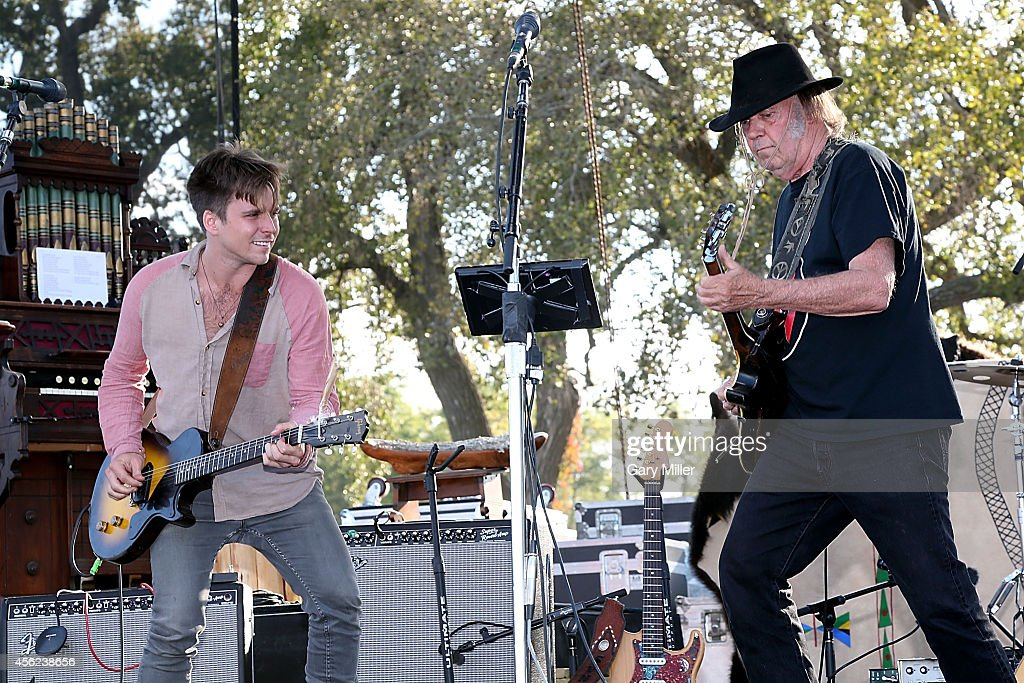 Lukas Nelson and Neil Young perform on stage during the Harvest The Hope concert on the Tanderup Farm on September 27 2014 in Neligh Nebraska