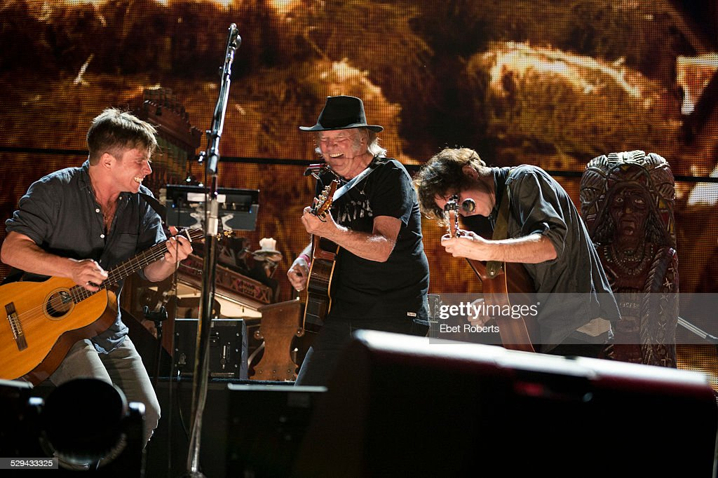 Lukas Nelson Neil Young and Micah Nelson performing at the 2014 Farm Aid concert on September 13 2014 at Walnut Creek Amphitheatre in Raleigh North...