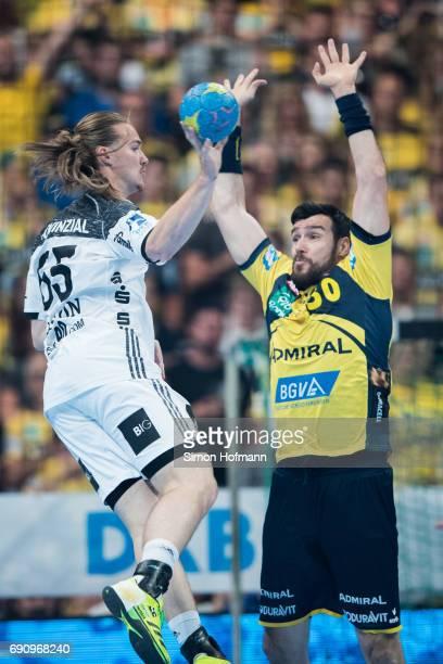 Lukas Nilsson of Kiel tries to score against Gedeon Guardiola Villaplana of RheinNeckar Loewen during the DKB HBL match between RheinNeckar Loewen...