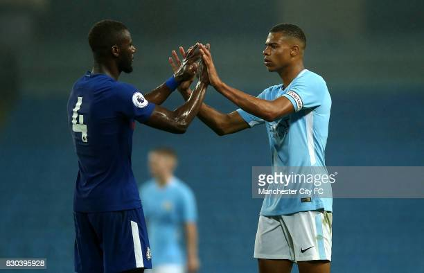 Lukas Nmecha of Manchester City and Joseph Colley of Chelsea shake hands at the final whistle during the Premier League 2 match between Manchester...