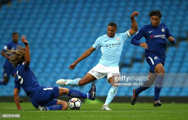 Lukas Nmecha of Manchester City has his shot at goal blocked by Ethan Ampadu of Chelsea during the Premier League 2 match between Manchester City and...