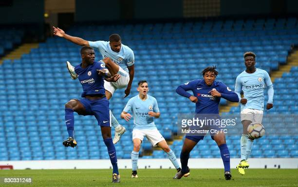 Lukas Nmecha of Manchester City heads at goal under pressure from Joseph Colley of Chelsea during the Premier League 2 match between Manchester City...