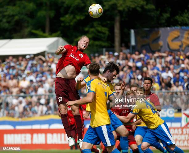 Lukas Nottbeck of Viktoria Koeln jumps for a header during the Third League Plaffoff match between Viktoria Koeln and FC CZ Jena at Sportpark...