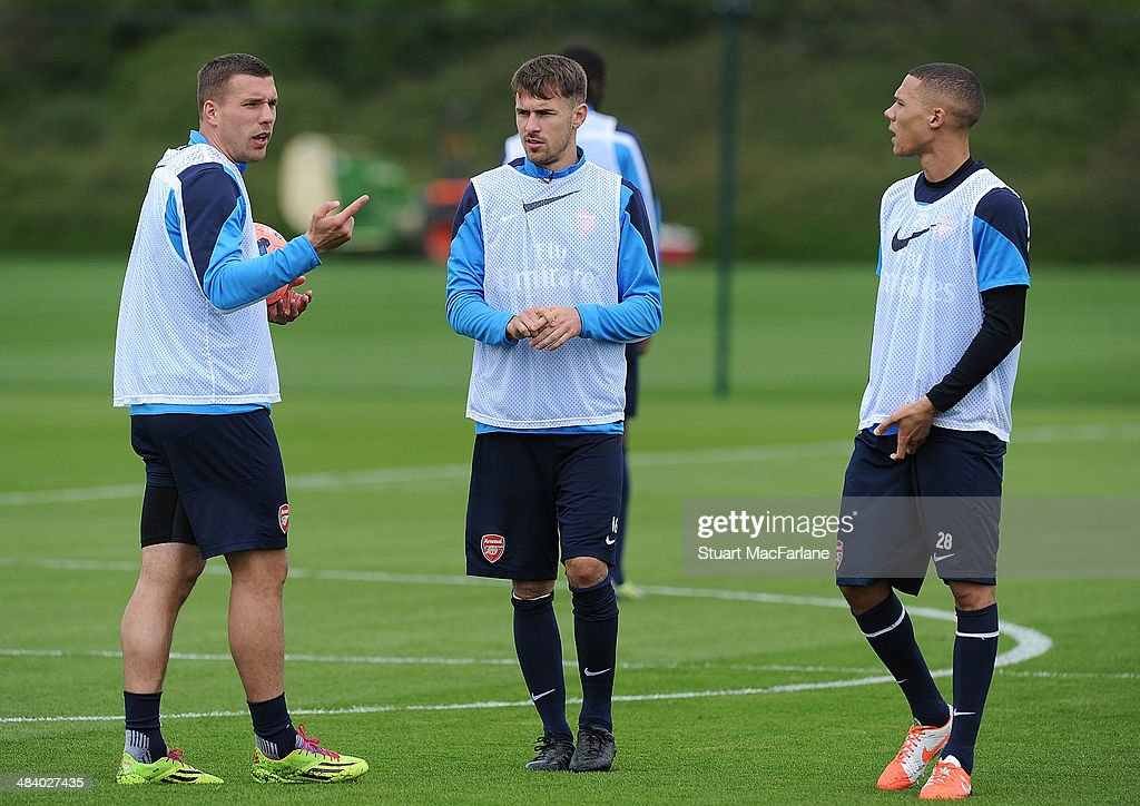 Lukas Podolski; Aaron Ramsey and Kieran Gibbs of Arsenal during a training session at London Colney on April 11, 2014 in St Albans, England.