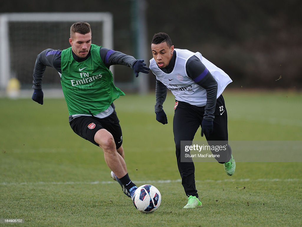 Lukas Podolski and Francis Coquelin of Arsenal during a training session at London Colney on March 29 2013 in St Albans England