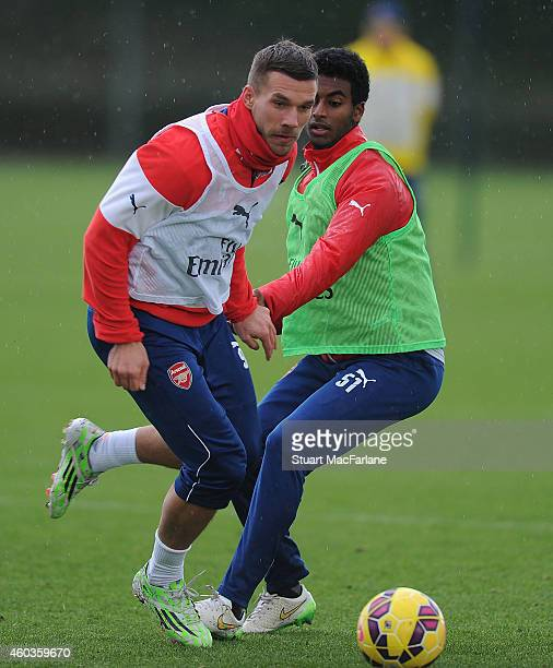 Lukas Podolski and Gedion Zelalem of Arsenal during a training session at London Colney on December 12 2014 in St Albans England Photo by Stuart...