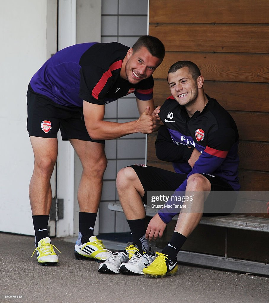COVERAGE** Lukas Podolski and Jack Wilshere of Arsenal before a training session at London Colney on August 24 2012 in St Albans England