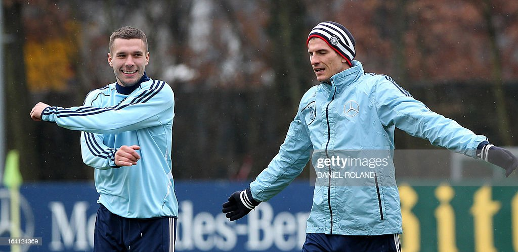 Lukas Podolski (L) and Mario Gomez of the German national football team attend a training session prior to the World Cup qualifyer against Kazakhstan in Frankfurt, Germany, on March 20, 2013.