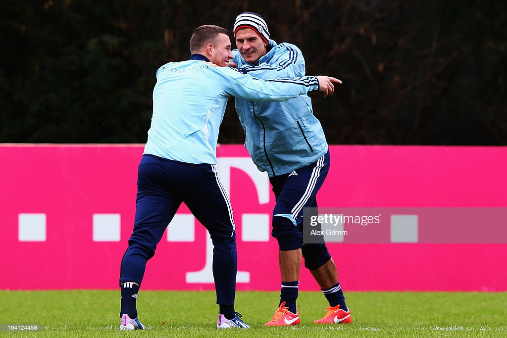 <a gi-track='captionPersonalityLinkClicked' href=/galleries/search?phrase=Lukas+Podolski&family=editorial&specificpeople=204460 ng-click='$event.stopPropagation()'>Lukas Podolski</a> (front) and <a gi-track='captionPersonalityLinkClicked' href=/galleries/search?phrase=Mario+Gomez+-+Soccer+Player&family=editorial&specificpeople=635161 ng-click='$event.stopPropagation()'>Mario Gomez</a> warm up during a Germany training session at 'Kleine Kampfbahn' training ground on March 20, 2013 in Frankfurt am Main, Germany.