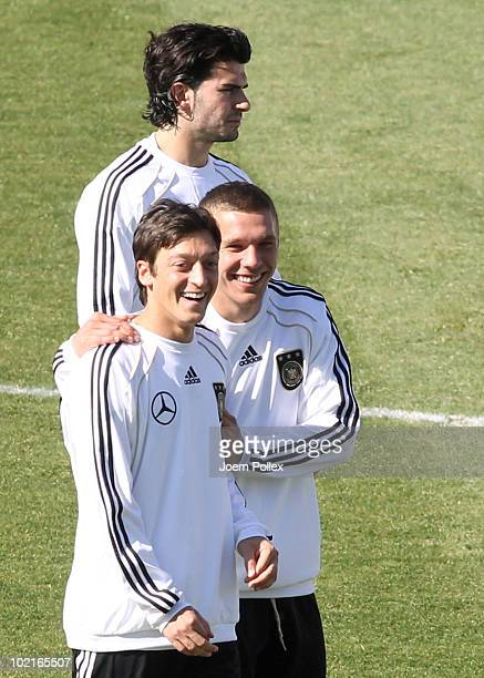 Lukas Podolski and Mesut Oezil of Germany joke during a training session at Super stadium on June 17 2010 in Pretoria South Africa