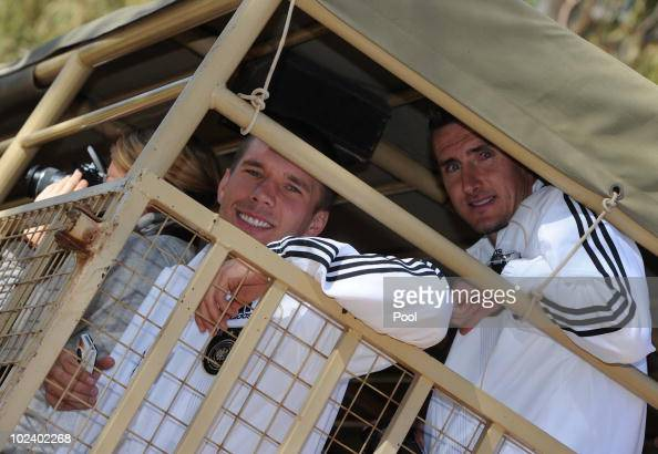 Lukas Podolski and Miroslav Klose of the German national football team take are seen driving with a van during a visit of the Lion Park on June 25...
